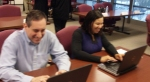United Way staff members Brian Fiorino and Denise Demby check out the new laptop computers.